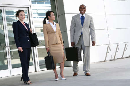 A diverse attractive business team leaving the company