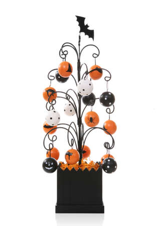 A colorful Halloween tree over a white background