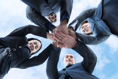 Photo pour A diverse business man and woman team with hands together a - image libre de droit