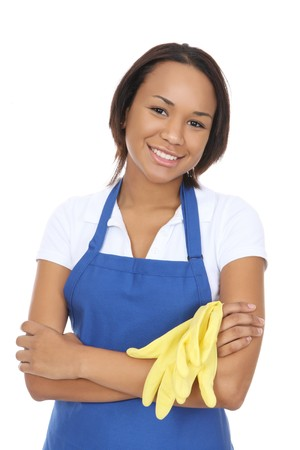 A pretty woman maid cleaner holding gloves