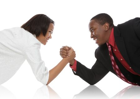 Attractive african american business man and woman arm wrestling