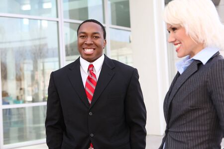Attractive business man and woman team at the office building