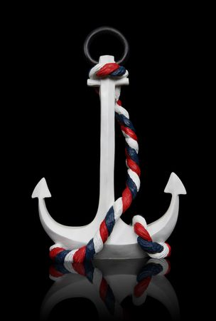 An old  anchor isolated over black background