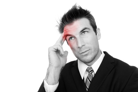 A business man with a headache isolated over white