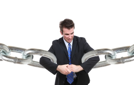 A business man struggling to make a connection with chain links