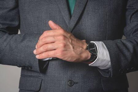 Photo pour Businessman is wearing a wrist watch close up. - image libre de droit