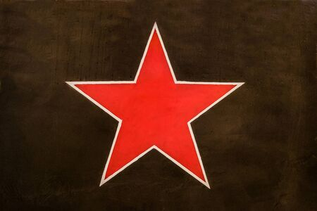 Red Soviet star on a dark green protective camouflage background. Identification sign aircraft of the Soviet air force on the khaki background.