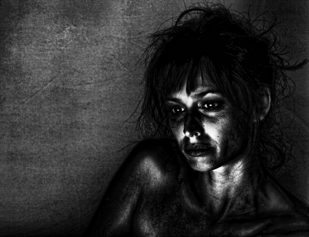 Artistic portrait of a sad woman in dramatic lighting.