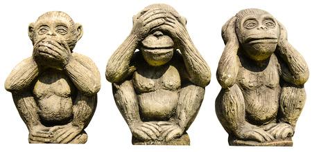 Three monkeys statues isolated