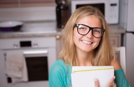 Photo of girl with glasses in kitchen