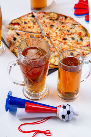 Photo for Photo of mugs with foam beer, pizza, pipes - Royalty Free Image