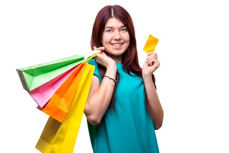 Photo pour Happy young woman with shopping bags and credit card - image libre de droit