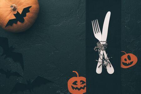 Photo pour Photo of halloween pumpkin, knife, fork, plate, bat . - image libre de droit