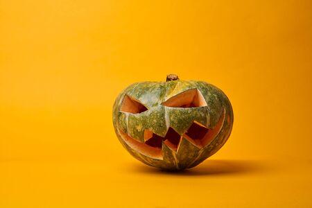 Foto de Picture of halloween pumpkin on empty orange background - Imagen libre de derechos