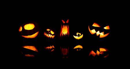 Foto de Image of halloween pumpkins with burning mouths on blank black background. - Imagen libre de derechos