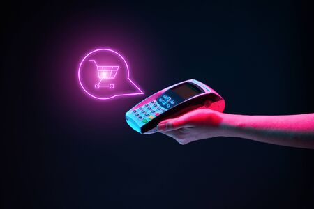 Photo pour Hand wit pin pad in neon colors. Concept of internet shopping - image libre de droit