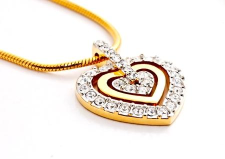 Photo pour heart shape diamonds locket on white background - image libre de droit