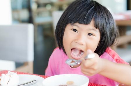 Asian girl enjoy her breakfast