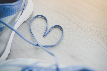Photo pour Love sign, Selective focus close up blue sport shoes on gray floor. - image libre de droit