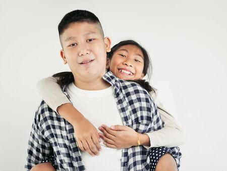 Photo for Happy Asian pretty girl enjoying riding on her brother piggyback, lifestyle concept. - Royalty Free Image