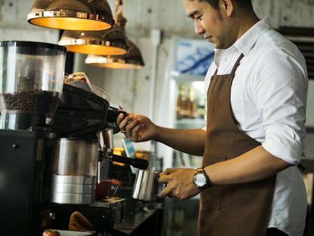Foto de Happy Asian barista man working in cafe, lifestyle concept. - Imagen libre de derechos