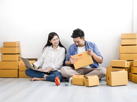 Photo for Asian couple with stack of parcel boxes, online business and delivery concept. - Royalty Free Image