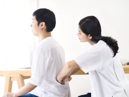 Photo pour Asian Orthopedic doctor with breathing and back examination for her patient, work concept. - image libre de droit