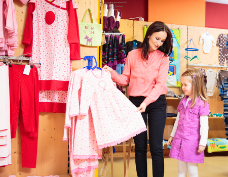 Mother And Daughter At Childrens Store