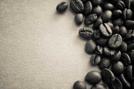 coffee beans on vintage color paper background