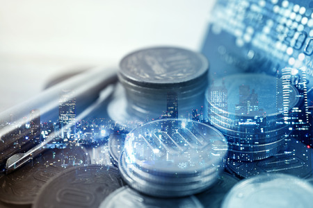 Photo pour Double exposure of city and rows of coins for finance and banking concept - image libre de droit
