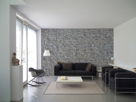 Photo pour living room with natural stone wall and copyspace for your own images - image libre de droit