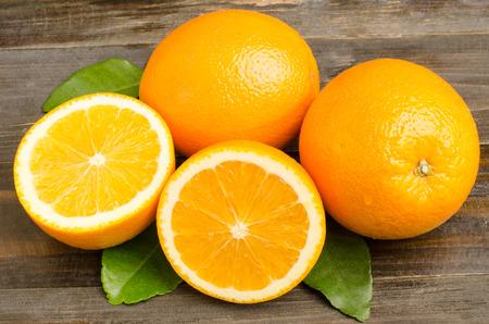 Fresh Navel orange fruit on wooden background,healthy food