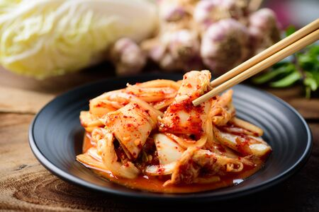 Photo for Kimchi cabbage on black plate eating by chopsticks, Korean food - Royalty Free Image