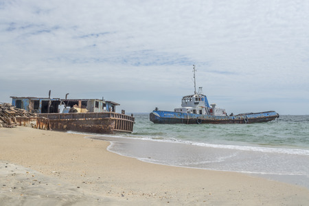 Ship cemetery on sea coast - Angola