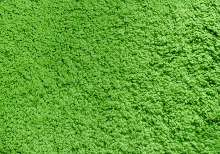 Fluffy green carpet, texture, background.