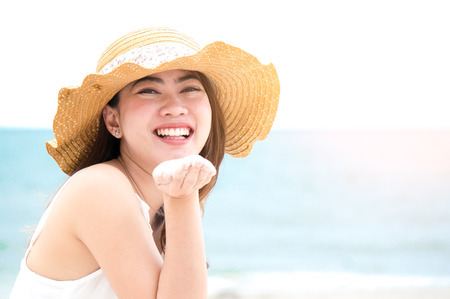Foto de Asian woman with smile on the beach and blue sea feeling relax in holiday close up - Imagen libre de derechos