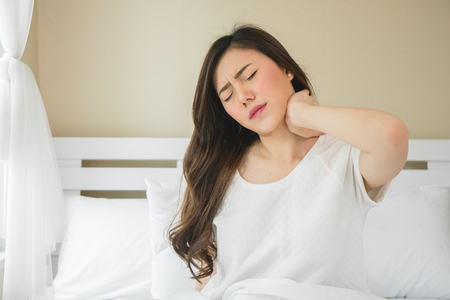 Photo for Asian woman have neckache in bedroom morning because sleep problem - Royalty Free Image