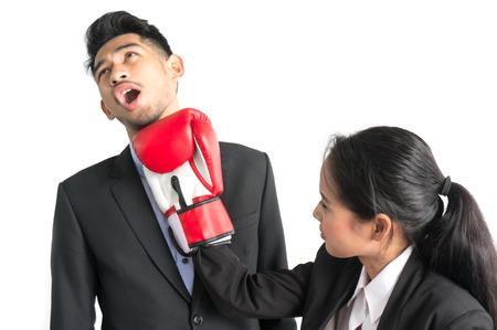 Foto de Business woman punch boss on white background - Imagen libre de derechos