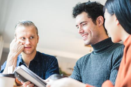 Photo pour Businessman and partners discuss about business plan in café - image libre de droit