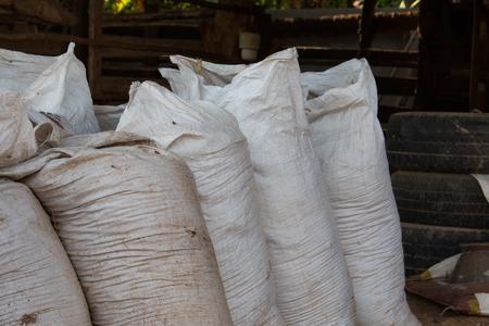Animal feed sacks cows