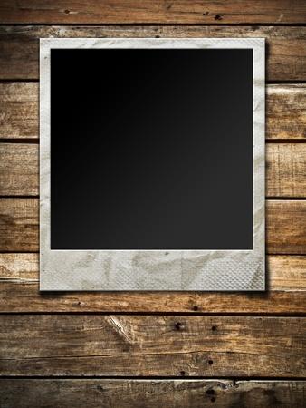 Old Polaroid photo frame on wood background
