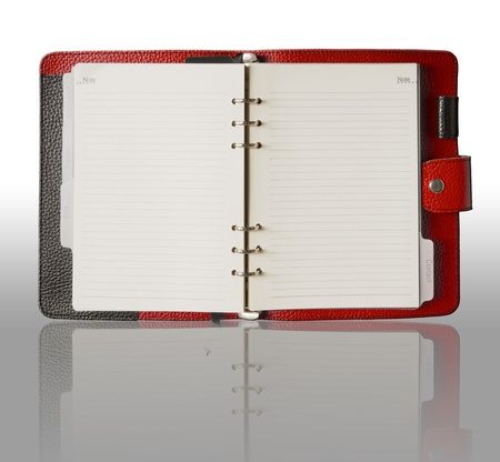 Red Leather cover binder book and reflection