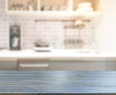 Photo pour Table Top And Blur Kitchen Room Of The Background - image libre de droit