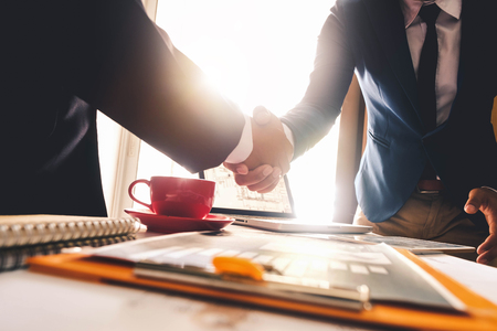 Photo for Two confident business man shaking hands during a meeting in the office, success, dealing, greeting and partner in sun light - Royalty Free Image
