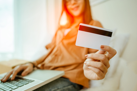 Photo for Hands holding credit card and using laptop. Online shopping - Royalty Free Image