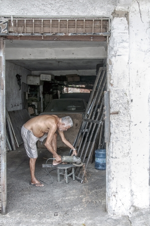 Elderly metalworker  People of community of the city center that will be expropriated and removed because of the World Cup 2014, Fortaleza, Brazil