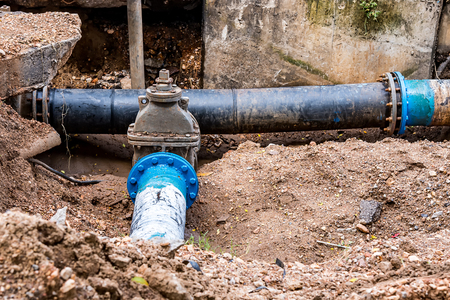 Photo for Water PVC Plastic Pipes in Ground during Plumbing Construction site. - Royalty Free Image
