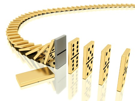 On a image  is shown golden domino bones on a white background  in action of  dominoes effect which was halted with help of particular domino bone placed instead of the usual which lies close