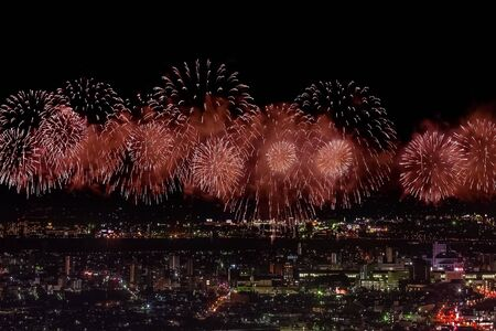 Foto per Festive salute in the night sky. Salute over the city the megalopolis. Explosions of fireworks. - Immagine Royalty Free
