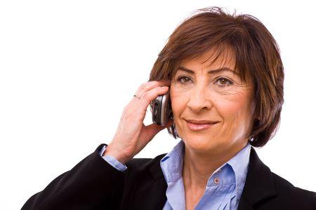 Senior businesswoman calling on mobile phone isolated on white background.